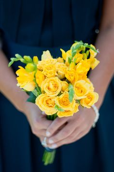 Yellow bouquet and bridesmaid's blue dress.    Yellow and blue complement each other! :)