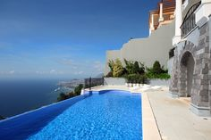 Amazing villa with private heated pool, next to golf course with stunning sea and mountain views.