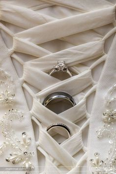 I haven't seen a photo like this before & I love the idea! Since my dress has buttons I'm going to hang them off the buttons.