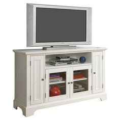 Wood media console with two side doors and adjustable shelving.    Product: Media console    Construction Material:
