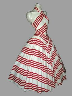 Absolutely gorgeous use of stripes. One would need great shoulders and a tiny waist to wear it, though!