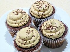 Love coffee with your dessert? This coffee-cream cheese frosting will get you your fix! Cream cheese and instant coffee team up to make a velvety and deliciously tangy topping for cupcakes, brownies, or whatever else your java-loving heart desires. | CDKitchen.com