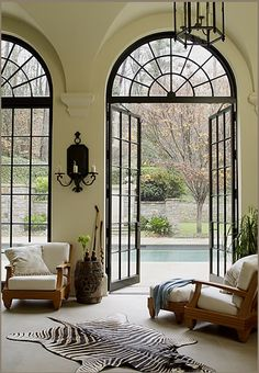 If I win the lottery, I am definitely getting myself some French doors with arched transoms---in my new mansion!!