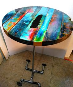 These colorful round table tops are made from vintage reclaimed doors and then layered in color over their original patina. They are a great way to splash some color around your game room, kitchen and dining room, breakfast nook, or any room in your space that begs for some color. They can be made with or without the pool queue rests, and with an emphasis on any color that works with your daecor. The table tops in the photos are 22 inches in diameter and are sitting on pipe-leg props for the…