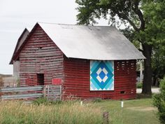 One of my favorites! Beautiful quilt block on weathered red barn in Iowa