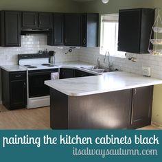 how to paint kitchen cabinets black/new counter/white subway tile backsplash