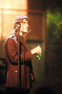 """reluctant-martyrs: """"Liam Gallagher of Oasis at the MTV Video Music Awards Show, c. 1996 © Jeff Kravitz/FilmMagic """""""