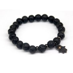 """Hand"" Lava Stone Bracelet – 11.95$    Crafted with one 18kt gold plated Hamsa pendant and 8mm lava stone beads.  Crafted with 0.8 mm elastic cord.  Adjustable size. Can fit size 6,7"" to  7,5""  (17-19 cm)  Colors: Gold , Rose Gold , Silver ,Black"