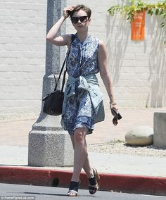 Ready for summer! Lily Collins  stepped out in LA on Monday, wearing a sleeveless floral p...