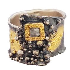 """oxidized sterling silver fashion ring with 18K vermeil accents and """"molten"""" bead texture on center of ring.  raw diamond cube in an 18K vermeil square. (JCK Design Award) from eva stone"""