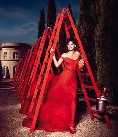 Don't walk under the ladder?  Penelope Cruz is Red Hot in the 2013 Campari Calendar