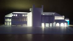 quick built card architecture model, illuminated to show how it emmits light into street
