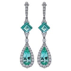 platinum earrings featuring green Tourmaline (29.76 ctw.) accented with blue Tourmaline (4.0 ctw.) and Diamonds (2.87 ctw.) from AGTA Member, Featherstone Design.