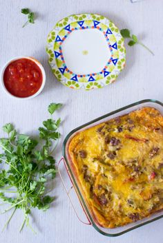 Breakfast enchiladas start with simple whole wheat tortillas layered with peppers, sausage, onions and egg ohsweetbasil.com_-3