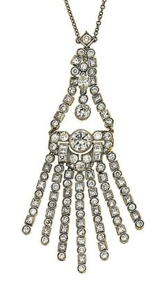 A diamond pendant   The triangular openwork surmount alternately-set with square and brilliant-cut diamonds and a marquise-cut diamond accent, to a similarly-set geometric panels suspending a diamond-set tassel, the whole to a trace-link chain, pendant 7.0cm long