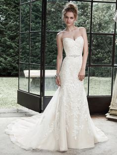 Maggie Sottero - WINSTYN, Dreamy lace and tulle combine to create this elegant fit and flare wedding dress