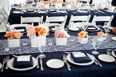 Navy blue tablecloths with blue/white damask runners. So elegant!