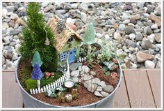 Fairy garden made out of a galvanized tub from findinghome.com