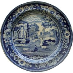 This lovely blue and white transferware plate dates to about 1825. It is 6 inches in diameter and has an edge nick at about the 9:00 position,