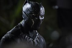 Black Panther (2018)_ Scene of T'Challa in costume in Marvel's Black Panther film.