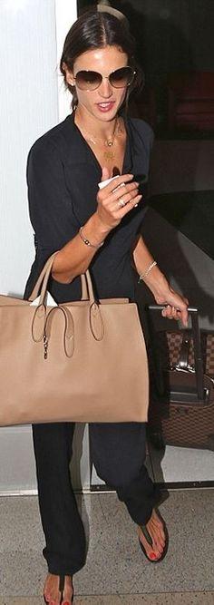 Who made Alessandra Ambrosio�s brown print luggage and tan handbag