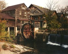The old grist mill in Pigeon Forge, Tn. is a rustic structure with a working mill wheel.
