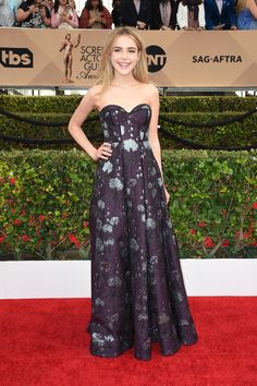 Kiernan Shipka in a deep purple Erdem gown.