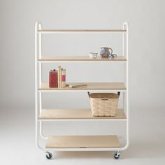 Inspired by rolling carts found in classic French bakeries. Well-proportioned for both display and storage, our Foundry Cart is expertly crafted in the USA by a family-owned fabrication shop. Perfect for kitchens, pantries, offices and enryways, it's casters are non-marking and may be locked, so you can safely move your wares where you desire. Powder-coated steel frame with lacquered wood shelving. A Schoolhouse Electric Exclusive.