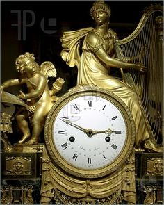 French Antique Clock gold with intricate detail from the early 18th. century.