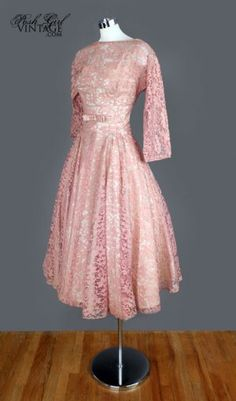 50's prom dress.  http://www.poshgirlvintage.com/1950s-blush-mauve-lace-tea-length-evening-dress-m-p-2813.html