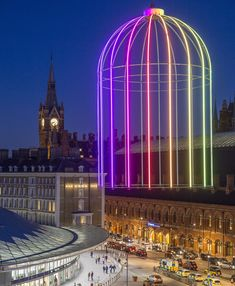 "IFO (Identified Flying Object) is an art installation at King's Cross. This 9-metre high neon ""birdcage"" lights up Battle Bridge Place at night."