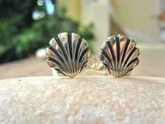 St James camino scallop cufflinks. The shell of Saint James or La Vieira is the traditional emblem of Santiago, and is popular with pilgrims on the Way of St James (El Camino de Santiago . . or simply, El Camino) travelling to the apostle's shrine at Santiago de Compostela in Galicia. Medieval Christians making the pilgrimage to the shrine often wore a scallop shell symbol on their hat or clothes - just as modern-day walkers do nowadays.