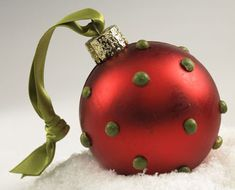 glue beads or rhinestones to a plain ball & add matching ribbon - for next year...
