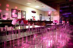Ghost chairs, flower-topped tables, and swirling pink lights spruced up the deli area. Photo: Liliane Calfee