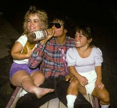 Michael Jackson... chugging vodka... with 2 midgets on his lap.  I'd say that'd be one of his more normal moments.