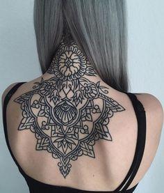 geometric nape tattoo