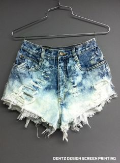 Love destroyed high waisted shorts. DIY with old boys jeans and some bleach!
