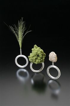 "Landscape Sample Rings  2007  sterling silver, model railroad landscape materials—""bush,"" ""field grass,"" ""talus""  each approx. 2"" x 1.5"" x .5""  one-of-a-kind  private collection"