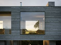External image of Upper Parkbrae Contemporary House. Siberian Larch timber cladding and grey Danish brick.