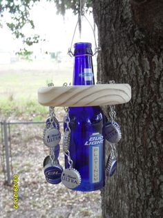Beer bottle wind chime...I was thinking with a ibc root beer or cream soda bottle cause we don't drink