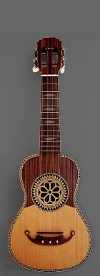 Model: Rosette Hole in Boxwood | Soundboard: Fir | Half-board: Madagascar Rosewood | Back: Madagascar Rosewood | Sides: Madagascar Rosewood | Neck : Mahogany | Fretboard: Madagascar Rosewood | Inlays: Ivory Built-in | Year: 2003