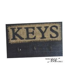 Handcrafted Wooden Key Holder with 3 Hooks, Hand-Painted $15.00 This item comes ready to hang. It is handmade by a skilled woodworker from recycled wood, on a natural burlap fabric. It has 3 hooks that are very strong and sturdy. This key rack will help keep you organized and ready to go, so it is a vital piece of home decor for everyone! 9 inches wide and 5.5 inches high Want a different color, or maybe a different number of hooks? Just send us a custom request!