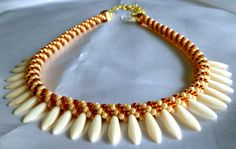 Ivory & dark topaz beaded Kumihimo dagger necklace, statement necklace, gifts for her, adjustable length by TheBeckoningCat on Etsy https://www.etsy.com/listing/400711933/ivory-dark-topaz-beaded-kumihimo-dagger