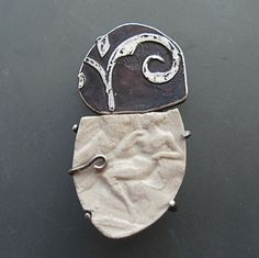 fragment series, brooch #2 by lora hart... .999 Silver clay, sterling, steel, porcelain. Kiln Fired, soldered, set.