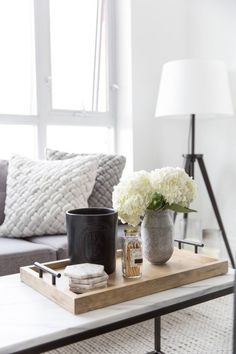 Small-Space Living: Mastering Minimalism in 800 Sq Ft coffee table tray inspo. Coffee Table Games, Coffee Table Vignettes, Unique Coffee Table, Coffee Table Styling, Cool Coffee Tables, Decorating Coffee Tables, Modern Coffee Tables, Coffee Table Centerpieces, How To Style Coffee Table