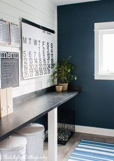 Navy Laundry Room Makeover---December 2014. The Lilypad Cottage. Lovely~ The color she chose was Cadet Song by Valspar. I love this grayish navy color, it's so dark, it's just shy of black.