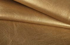Add a bit of bling to your interior design with this striking gold metallic upholstery fabric. It's the perfect low-cost option for designing on a budget.