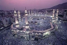 Mecca during Hajj. Every available spot filled with faithful people praying.