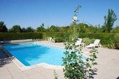 The swimming pool is hidden from the castle and secluded in a green environment