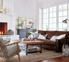 Rustic living room with a square arm leather sofa, Pottery Barn JODIE PRINTED RUG and vintage inspired furniture // Pottery Barn neutral rugs sale